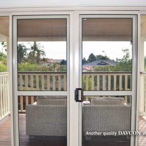 Sliding crimsafe security doors leading onto back patio